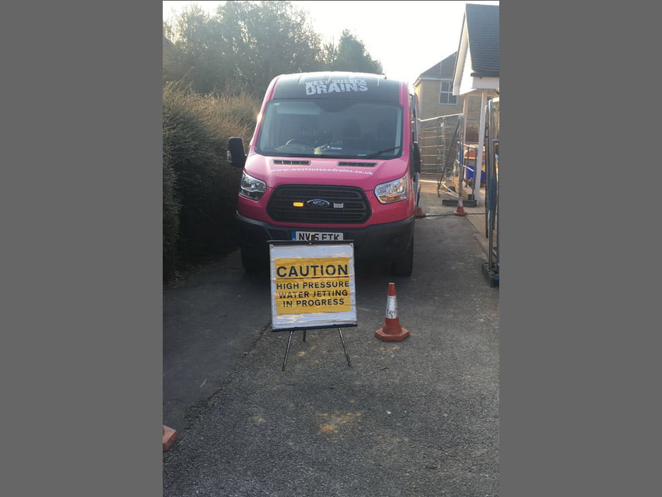 West Sussex Drains van with Caution sign