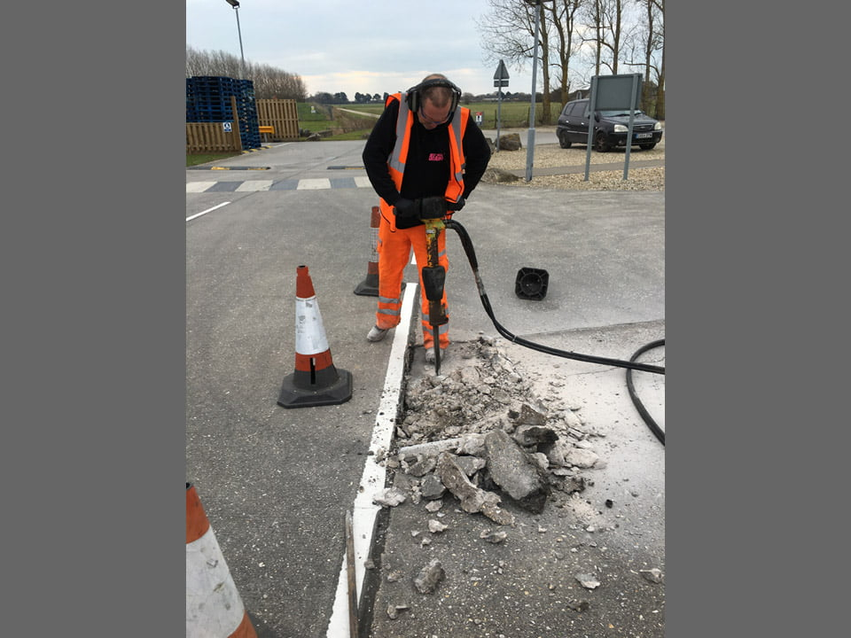 Workman drilling for a commercial job